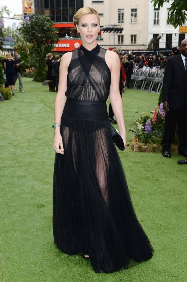 Today's Premiere Diva: Charlize Theron opts for black sheer glamour